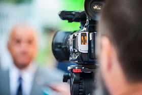 Camera Operator Recording Video Content