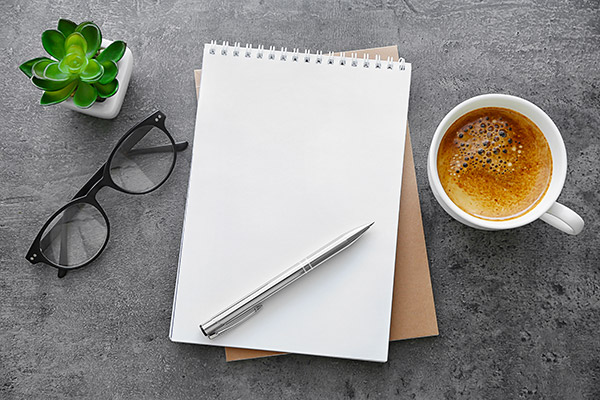 Custom Video Script Writing Notepad with Coffee on Desk
