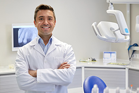 Smiling Dentist Recording a Video
