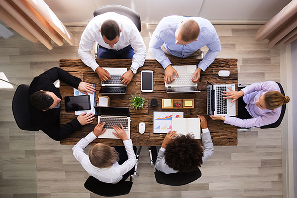 Team of Employees Working around Table